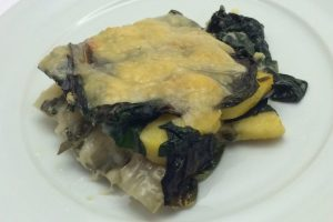 Polenta pasticciata con coste e fontina